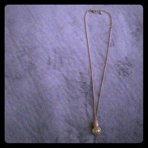 Gold potion necklace